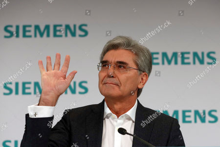 Joe Kaeser, CEO of German industrial conglomerate Siemens waves as he arrives for the company's annual press conference in Munich, Germany