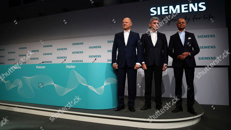 Stock Image of Joe Kaeser, CEO of German industrial conglomerate Siemens, center, CFO Ralf P. Thomas, left, and CEO of Siemens Energy, Michael Sen, arrive for the company's annual press conference in Munich, Germany