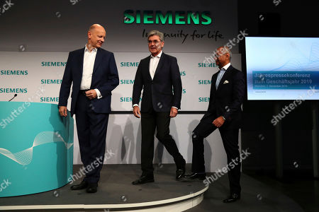 CFO of German industrial conglomerate Siemens, Ralf P. Thomas, from left, CEO Joe Kaeser, center, and CEO of Siemens Energy, Michael Sen, arrive for the company's annual press conference in Munich, Germany
