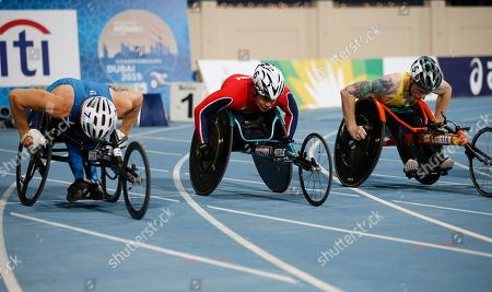 (L-R) Leo Pekka Tahti of Finland ,Tomoki Ikoma of Japan  and Luke Bailey of Australia compete in the men's 100m T54 final at the World Para Athletics Championships in Dubai, UAE, 07 November 2019.