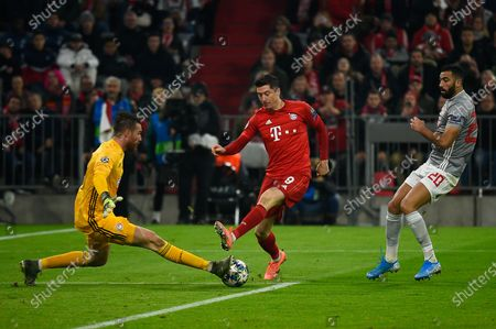 Stock Image of José Sá from Olympiacos (L), Robert Lewandowski from Bayern (C) and Yassine Meriah from Olympiacos (R)