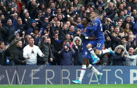 Tammy Abraham of Chelsea celebrates scoring a goal to make the score 1-0 with Christian Pulisic of Chelsea