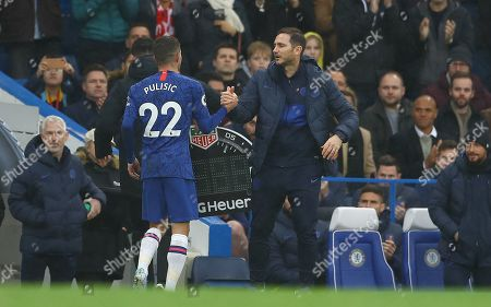 Christian Pulisic of Chelsea shakes hands with manager Frank Lampard after being substituted