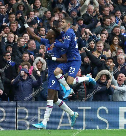 Tammy Abraham of Chelsea celebrates scoring a goal to make the score 1-0 with fellow goalscorer Christian Pulisic