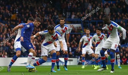 Stock Image of Christian Pulisic of Chelsea is surrounded by Crystal Palace players as he goes on the attack