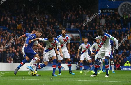 Christian Pulisic of Chelsea is surrounded by Crystal Palace players as he goes on the attack
