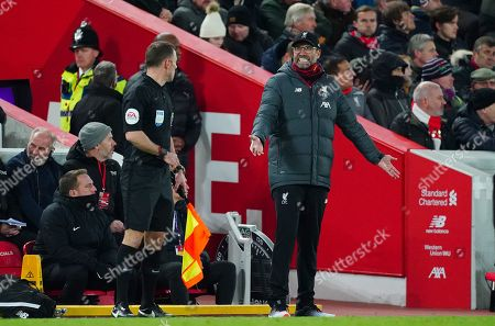 Liverpool manager Jurgen Klopp questions the assistant referee after Bernardo Silva of Manchester City scores a goal to make the score 3-1