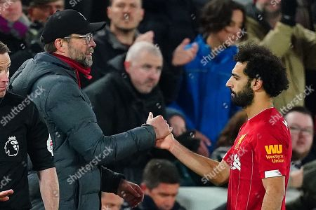 Liverpool manager Jurgen Klopp shakes hands with Mohamed Salah as he is substituted
