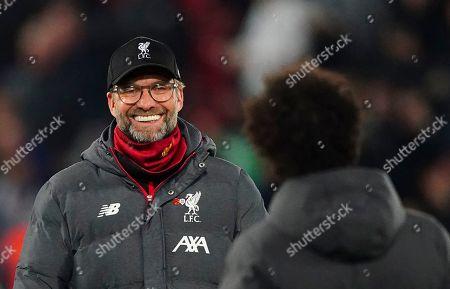 Liverpool manager Jurgen Klopp smiles towards Mohamed Salah