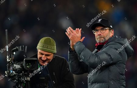Liverpool manager Jurgen Klopp with the Sky Sport steadicam operator next to him