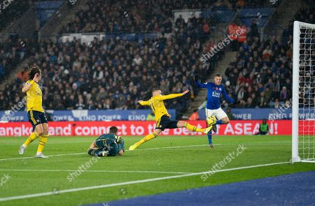 Stock Picture of Calum Chambers of Arsenal breaks up a scoring chance for Jamie Vardy of Leicester City