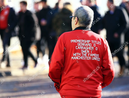 Stock Picture of A Manchester United fan arrives wearing a jacket aimed at Steven Gerrard and Jamie Carragher