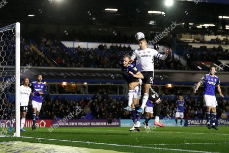 Aleksandar Mitrovic of Fulham challenges Birmingham City goalkeeper Lee Camp and Marc Roberts for the ball shortly before scoring the first goal