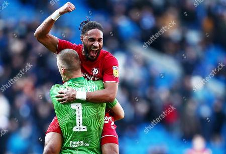 Ashley Williams celebrates with Daniel James Bentley of Bristol City.