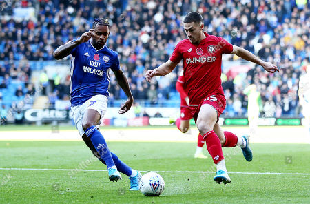 Tommy Rowe of Bristol City and Leandro Bacuna of Cardiff City.