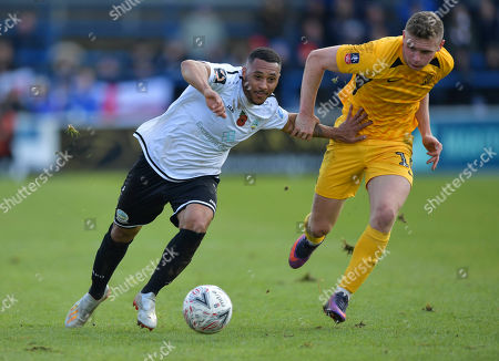 Aaron Simpson of Dover Athletic under pressure from Ethan Hamilton of Southend United