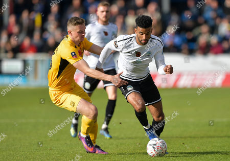 Stock Image of Oscar Gobern of Dover Athletic under pressure from Ethan Hamilton of Southend United
