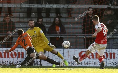Ched Evans of Fleetwood Town scores the opening goal