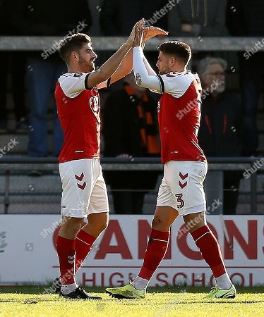 Ched Evans of Fleetwood Town celebrates scoring the opening goal with team-mate Danny Andrew