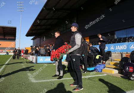 Darren Currie manager of Barnet and Joey Barton manager of Fleetwood Town with Poppy remembrance wreaths
