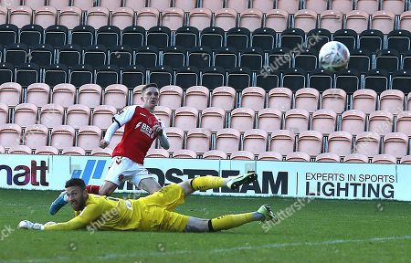 Ashley Hunter of Fleetwood Town scores his sides second goal past Scott Loach of Barnet