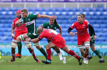 Stock Image of Franco van der Merwe (Captain) of London Irish breaks through Tom Youngs (Captain) of Leicester's tackle