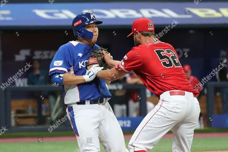 Canada's pitcher Christopher Leroux tags out South Korea's Kim Hyun-soo near the first base during the 7th inning of the group C of the WBSC Premier12 2019 world baseball tournament at Gocheok Sky Dome in Seoul, South Korea