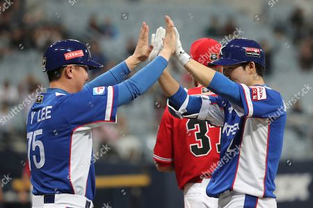 Stock Photo of Park Min-woo. Lee Jong-yeol. South Korea's Park Min-woo, right, celebrates with first base coach Lee Jong-yeol after hitting an RBI single off Canada's pitcher Dustin Molleken during the 9th inning of the group C of the WBSC Premier12 2019 world baseball tournament at Gocheok Sky Dome in Seoul, South Korea
