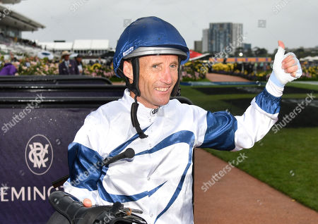 Australian jockey Damien Oliver poses after riding Miami Bound to victory in race 8, the Kennedy Oaks, during Oaks Day at Flemington Racecourse in Melbourne, Victoria, Australia, 07 November 2019.