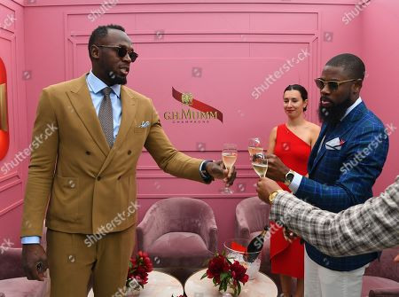 Stock Picture of Jamaican former sprinter Usain Bolt (L) toasts at the Mumm marquee during Kennedy Oaks Day at Flemington Racecourse in Melbourne, Victoria, Australia, 07 November 2019. The Kennedy Oaks Day, also known as the Ladies' Day, is part of the Melbourne Cup Carnival calendar.