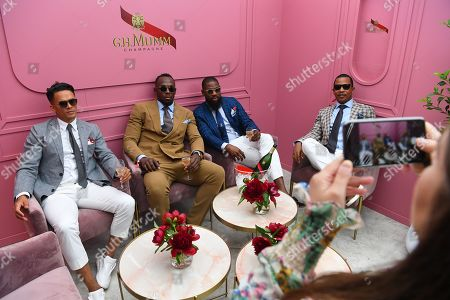 Jamaican former sprinter Usain Bolt 2-L) poses for a photograph at the Mumm marquee during Kennedy Oaks Day at Flemington Racecourse in Melbourne, Victoria, Australia, 07 November 2019. The Kennedy Oaks Day, also known as the Ladies' Day, is part of the Melbourne Cup Carnival calendar.