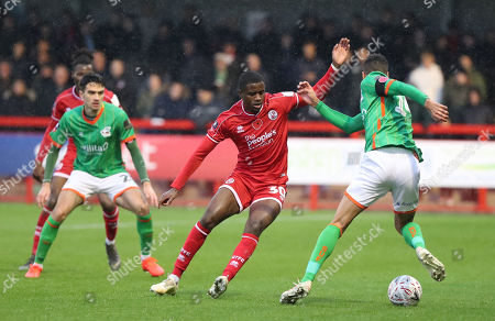 Stock Photo of Crawley Town's Beryly Lubala vies for the ball against Scunthorpe's James Perch during the Emirates FA Cup first round match between Crawley Town and Scunthorpe United at the Peoples Pension Stadium in Crawley. 09 November 2019