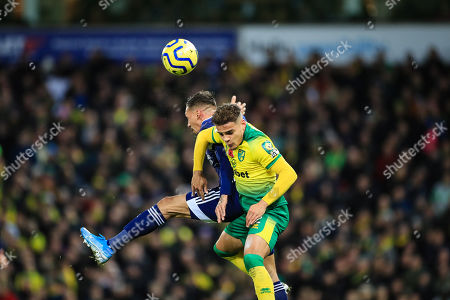 8th November 2019, Carrow Road, Norwich, England; Premier League, Norwich City v Watford : Max Aarons (02) of Norwich City and Daryl Janmaat (02) of Watford jump for the ball Credit: Georgie Kerr/News Images