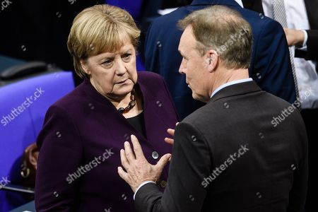 German Chancellor Angela Merkel (L) and the vice president of the German Parliament of the Social Democratic Party (SPD) Thomas Oppermann during a voting session, held on the election of a Alternative fuer Deutschland (AfD) candidate for the office of Bundestag vice president, during a session of the German parliament Bundestag in Berlin, Germany, 07 November 2019. Alternative for Germany party (AfD) Member of Parliament and candidate for the office of Bundestag vice president Paul Viktor Podolay's (not in the picture) first attempt to be elected as Vice President of the German Bundestag failed in September.