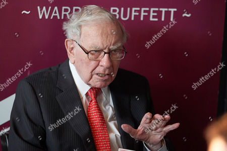 Warren Buffett, Chairman and CEO of Berkshire Hathaway, gestures during a game of bridge following the annual Berkshire Hathaway shareholders meeting in Omaha, Neb. Three-quarters of the way through 2019, Buffett's conglomerate Berkshire Hathaway is trailing the renowned investor's favorite benchmark, the S&P 500, as it's done over the past decade