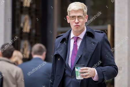 Stock Photo of Conservative British commentator Milo Yiannopoulos arrives to attend the trial of Roger Stone, former advisor to US President Donald J. Trump, at DC Federal District Court in Washington, DC, USA, 07 November 2019. Stone has been charged with seven counts of obstruction of justice, making false statements and witness tampering.