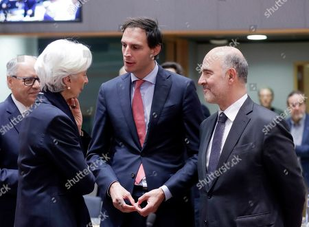 Stock Photo of (L-R) President of the European Central Bank (ECB) Christine Lagarde, Dutch Minister of Finance Wopke Hoekstra and Pierre Moscovici, European Commissioner for Economic and Financial Affairs attend a Eurogroup Finance Ministers' meeting in Brussels, Belgium, 07 November 2019.