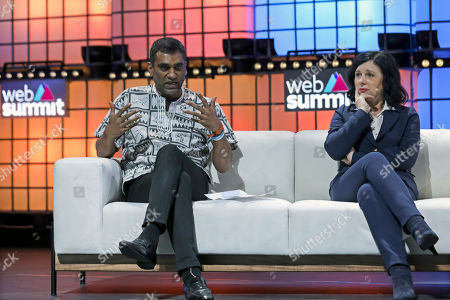 Kumi Naidoo (L) Secretary-General of Amnesty International (AI), flanked by EU Commissioner for Justice, Consumers & Gender Equality and Vice-President-designate for Values and Transparency, Vera Jourova (R), speaks in the 2019 Web Summit at Atlantic Pavilion in Lisbon, Portugal, 07 November 2019. The 2019 Web Summit, considered the largest event of startups and technological entrepreneur ship in the world, takes place from 04 to 07 November.