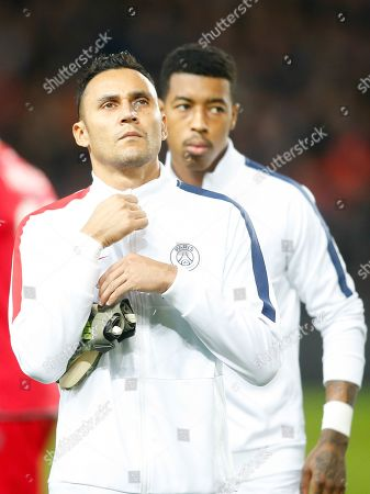 Stock Picture of PSG's goalkeeper Keylor Navas, followed by Presnel Kimpembe, prepares for the start