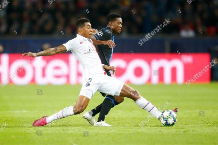 PSG's defender Presnel Kimpembe vies for the ball with Bruge's forward