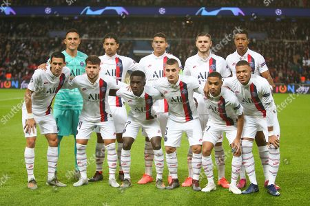PSG's players: (L to R background) goalkeeper Keylor Navs, midfielder Marquinhos, captain Thiago Silva, forward Mauro Icardi and defender Presnel Kimpembe, (L to R front) forward Angel Di Maria, defender Juan Bernat Velasco, midfielder Idrissa Gueye, defender Colin Dagba and forward Kylian Mbappe pose before the start