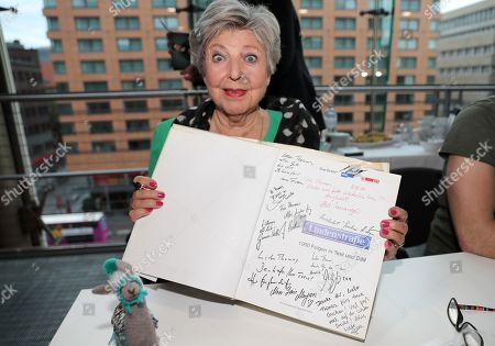Marie-Luise Marjan shows a book of Lindenstrasse during a fan meeting of the German television drama series 'Lindenstrasse' (lit. Lime Street) at the German Cinematheque (Deutsche Kinemathek) - Museum of Film and Television in Berlin, Germany, 07 November 2019. The TV series is broadcasted weekly by Das Erste since the first episode aired on 08 December 1985. The museum opens a new collection Lindenstrasse with 373 episodes of the series which are permanently in the inventory of the museum.