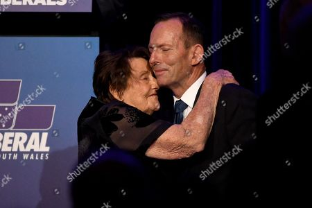 Former prime minister Tony Abbott (R) is embraced by his mother Fay Abbott during a tribute dinner for him at the Miramare Gardens in Sydney, New South Wales, Australia, 07 November 2019.