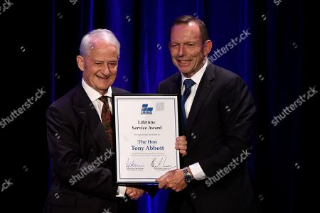 Philip Ruddock (L) presents former prime minister Tony Abbott with a Lifetime Service Award during a tribute dinner for him at the Miramare Gardens in Sydney, New South Wales, Australia, 07 November 2019.