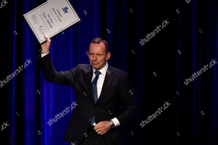 Former prime minister Tony Abbott holds up his Lifetime Service Award during his tribute dinner at the Miramare Gardens in Sydney, New South Wales, Australia, 07 November 2019.