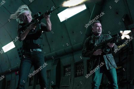 Linda Hamilton as Sarah Connor and Arnold Schwarzenegger as T-800/Carl