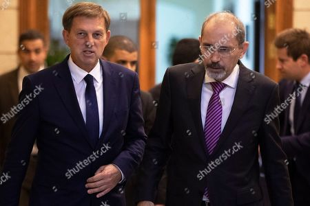 Slovenian Foreign Minister Miro Cerar (L) arrives with his Jordanian counterpart Ayman Safadi (R) to give a short statement, at the Foreign Ministry, in Amman, Jordan, 07 November 2019.