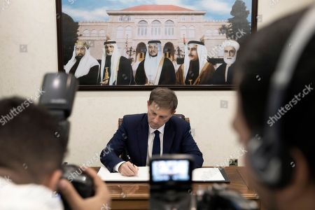 Slovenian Foreign Minister Miro Cerar signs the guest book during his visit at the Foreign Ministry, in Amman, Jordan, 07 November 2019.