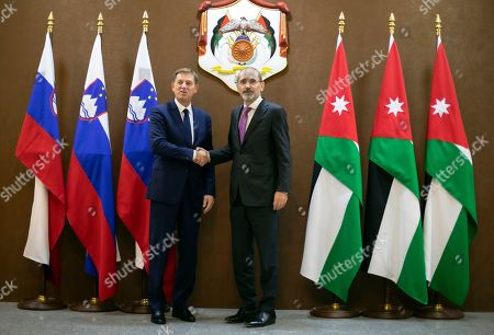 Jordan Foreign Minister Ayman Safadi (R) shakes hand with his Slovenian counterpart  Miro Cerar (L) at the Foreign Ministry, in Amman, Jordan, 07 November 2019.