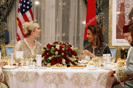 Stock Photo of Ivanka Trump, Lalla Meryem, Andre Azoulay. Ivanka Trump, the daughter and senior adviser to President Donald Trump, left, reacts as she talks with Princess Lalla Meryem of Morocco, during a dinner at the Royal Guest House in Rabat, Morocco. At far right is Andre Azoulay, senior adviser to Morocco's King Mohammed VI